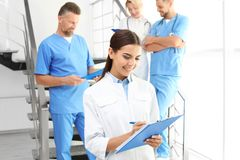 Doctors and medical assistants in clinic royalty free stock image
