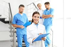 Doctors and medical assistants in clinic royalty free stock photo