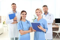 Doctors and medical assistants in clinic. Health care service royalty free stock photo