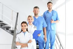 Doctors and medical assistants in clinic stock image