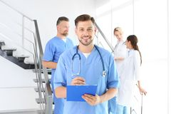Doctors and medical assistants in clinic. Health care service stock photo