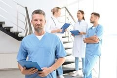 Doctors and medical assistants in clinic. Health care service stock photos