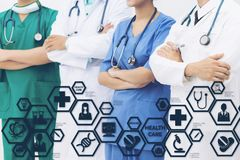Doctors with Medical Healthcare Icon Interface. Medical Healthcare Concept - Doctors in hospital with medical icons modern interface showing symbol of medicine stock photo