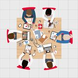 Doctors and Medical Professionals Meeting around Boardroom Table Stock Photo