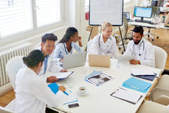 Doctors in medical school discussing. Group of doctors in medical school discussing and learning as team stock image