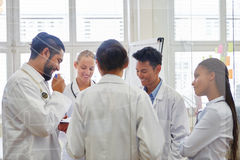 Doctors in medical training. Cooperating and learning as team royalty free stock image