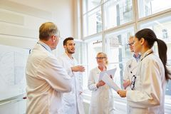 Doctors during medical training. Working together royalty free stock photography