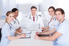 Doctors in meeting with clipboard and laptop Stock Images
