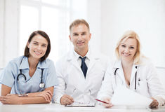 Doctors on a meeting Stock Photos