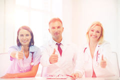 Doctors on a meeting. Healthcare and medical concept - group of doctors on a meeting showing thumbs up Royalty Free Stock Image