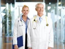 Doctors at modern hospital Stock Photos