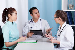Doctors during morning meeting Royalty Free Stock Images