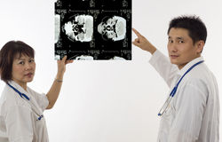 Doctors with MRI scan Stock Images