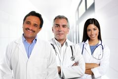 Doctors multiracial expertise indian. Doctors multi ethnic expertise indian caucasian latin in hospital Stock Photo