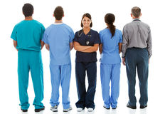Doctors: Nurse Faces to Camera with Others Turned Royalty Free Stock Photo
