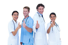 Doctors and nurse gesturing thumbs up Royalty Free Stock Photo