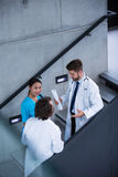 Doctors and nurse having a discussion on stairs Stock Photo