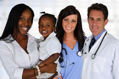 Doctors and Nurse With Patient Stock Image