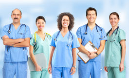 Doctors and nurses. Smiling medical people with stethoscopes. Doctors and nurses royalty free stock photos