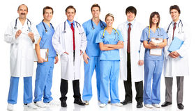 Doctors and nurses. Smiling medical people with stethoscopes. Doctors and nurses over white background stock photo