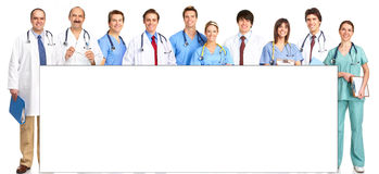 Doctors and nurses. Smiling medical people with stethoscopes. Doctors and nurses over white background Stock Image