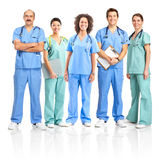 Doctors and nurses. Smiling medical people with stethoscopes. Doctors and nurses over white background Royalty Free Stock Photos