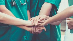 Doctors and nurses coordinate hands. Concept Teamwork royalty free stock photography