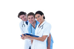 Doctors and nurses discussing over notes Stock Photography