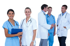 Doctors and nurses discussing over notes Stock Photos