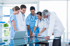 Doctors and nurses discussing together Stock Image