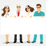 Doctors and nurses holding a blank billboard Stock Photography