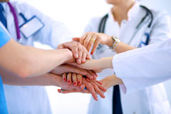 Doctors and nurses in a medical team stacking Stock Photos