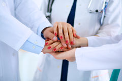 Doctors and nurses in a medical team stacking Stock Photography