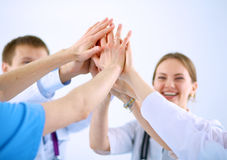 Doctors and nurses in a medical team stacking Royalty Free Stock Images