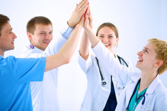 Doctors and nurses in a medical team stacking Royalty Free Stock Photos