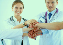 Doctors and nurses in a medical team stacking Royalty Free Stock Image
