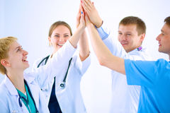 Doctors and nurses in a medical team stacking Royalty Free Stock Photography