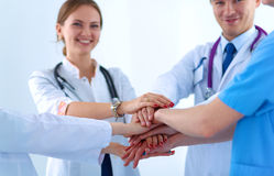Doctors and nurses in a medical team stacking Stock Image