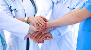 Doctors and nurses in a medical team stacking hands Royalty Free Stock Photography