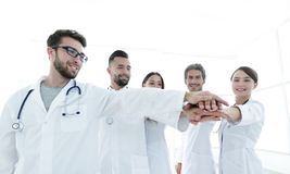Doctors and nurses in a medical team stacking hands Royalty Free Stock Images