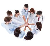 Doctors and nurses stacking hands. Isolated on white Royalty Free Stock Image