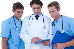 Doctors and nurses using laptop. Doctors and nurses using tablet on a white background Stock Photos