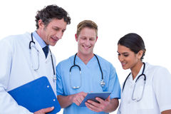 Doctors and nurses using laptop Stock Images