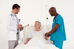 Doctors with a Patient Stock Images