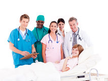 Doctors with a patient in a hospital. Doctors attending to a patient in a hospital Royalty Free Stock Images