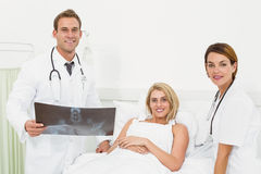 Doctors and patient with x-ray in hospital Stock Photo