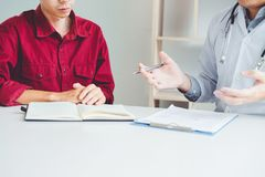 Doctors and patients sit and talk. At the table near the window royalty free stock photography