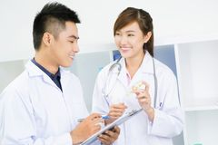 Doctors with pills Royalty Free Stock Photos