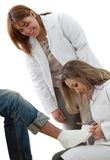 Doctors putting a cast Royalty Free Stock Photography