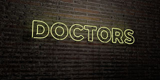 DOCTORS -Realistic Neon Sign on Brick Wall background - 3D rendered royalty free stock image Stock Photos